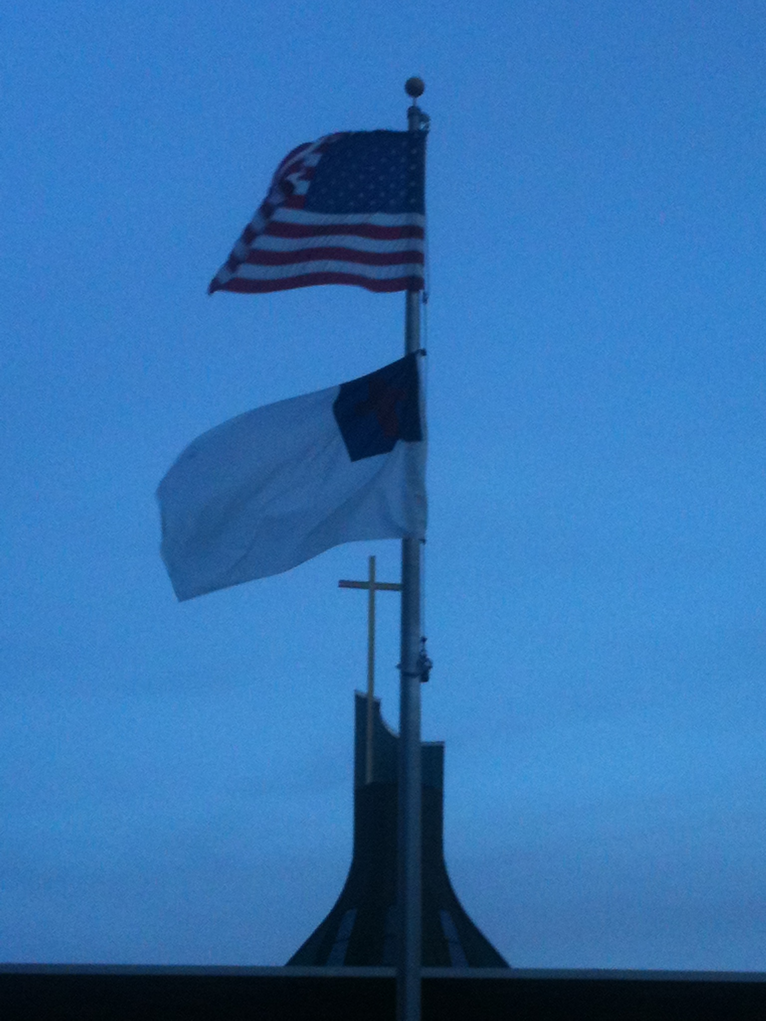 The U.S. Flag flying over the Christian Flag